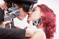 Business superhero love and hate. A weird couple of strange business superheroes in which she loves and hates him and they are attracted and the have to kill Stock Image