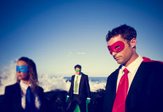 Business superheroes on the beach Royalty Free Stock Photos