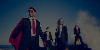 Business superheroes on the beach confident concept.  Royalty Free Stock Photography