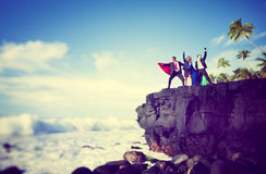 Business superheroes edge of cliff Stock Images