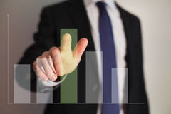Business sustainable development on a bar chart. Businessman presenting a successful sustainable development on a bar chart stock photos