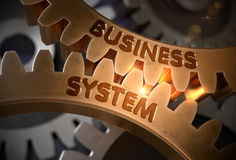 Business System Concept. Golden Cog Gears. 3D Illustration. Business System on Mechanism of Golden Metallic Gears with Lens Flare. Business System - Concept. 3D Stock Photography