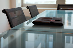 Business table. Meeting room with glas table and chairs in front of window Royalty Free Stock Image