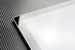 Business Tablet With Blank Screen And Reflection On Carbon Background Royalty Free Stock Photos