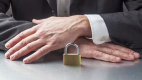 Business taboo or concept of security with code in hands Stock Photos