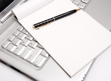 Business - Taking Notes by a Laptop Royalty Free Stock Images