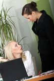 Business talk. Two business women having business talk  in the office Stock Photos