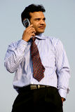 Business talk. Young business man talking on mobile phone Royalty Free Stock Photography