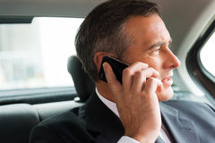 Business talk in car. Royalty Free Stock Photos
