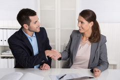 Business talk with shaking hands: counselor and customer or hell Stock Photos