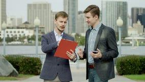 Business talk on a street in Coronado stock video