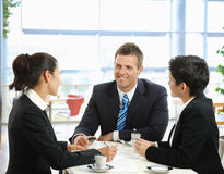 Business talking at cafe Stock Images