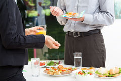 Business talks during lunch. Business colleagues talks during lunch, outdoor Royalty Free Stock Photo