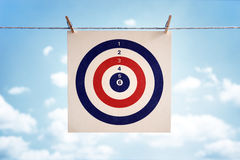 Business target. Target icon hanging from a clothesline concept for business strategy, goal or  bullseye Stock Photos