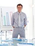 Business teacher standing before class Stock Image