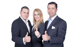 Business team. Young and  happy business team with one woman and two men isolated on white background, showing their thumbs Stock Images