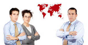 Business team. Two business men and business woman standing next to a world map Stock Photo