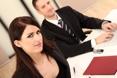 Business Team. Business man and business woman sitting at a desk stock photos