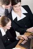 Business team. Two businesswomen and businessman working at office Royalty Free Stock Image