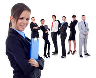 Business team. With a businesswoman holding a clipboard - isolated over a white background royalty free stock image