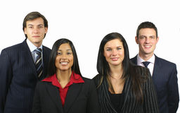 Business Team. Team of four young smiling business people Stock Image