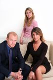 Business Team - 3 people. Group of young business people on sofa, serious expressions, conceptual confidence royalty free stock images