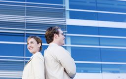 Business team. Business man and woman stand back to back Stock Images
