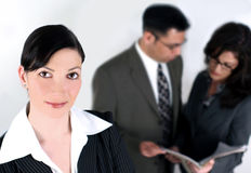 Business team. A business woman with her co-workers in the background Royalty Free Stock Photography