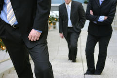 Business team. Three business people standing on steps faced forward Stock Image
