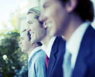 Business team. Three business men standing and smiling in same direction Royalty Free Stock Photo