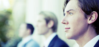 Business team. Three business men standing and looking in same direction Royalty Free Stock Images
