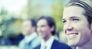Business team. Three business men standing and smiling in same direction Stock Photography