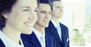 Business team. Three business people standing in a row looking in same direction Royalty Free Stock Images