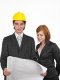 Business team. Two workers looking on blueprints Stock Photo