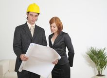 Business team. Two workers looking on blueprints Royalty Free Stock Image
