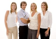 Business Team. A group of attractive young men and women in business wear Stock Images