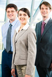 Business team. Team of three business people with leader in front Royalty Free Stock Photo
