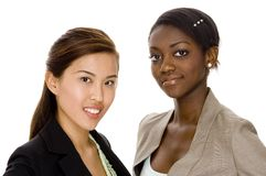 Business Team. Two young attractive businesswomen on white background Stock Image