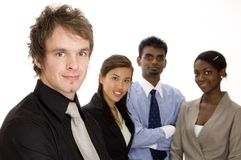 Business Team. A fashionable young businessman standing in front of his diverse business team Stock Photography