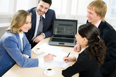 Business team. Four business people working in team stock images