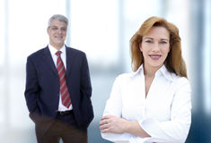 Business team. Woman and man in a corporate environment Royalty Free Stock Images