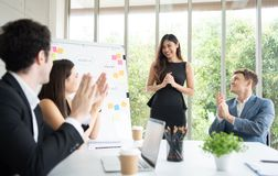 Business team achievement goals and Successful concepts. People are applauding to leader of project. Multiethnic stock photo