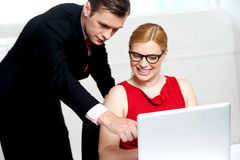 Business team in action. Man pointing at laptop Stock Image