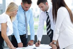 Business team adjusts work plan Stock Images