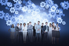 Business team against cogs and wheels background Stock Images