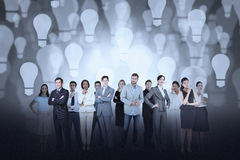 Business team against light bulb background Royalty Free Stock Images