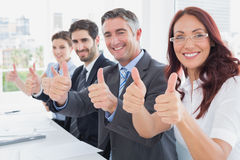 Business team all giving thumbs up Stock Photography