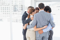 Business team all huddled together Royalty Free Stock Image