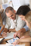 Business team analysing statistics Royalty Free Stock Photography