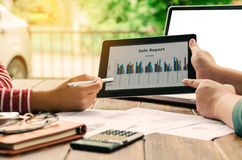 Business team analysis with financial graph in tablet at office, workplace, meeting. Stock Photos